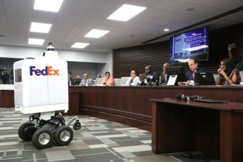 FedEx shows off one of its new same-day delivery robots at a Memphis City Council meeting. Memphis will be piloting the program.