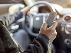 Handheld cell phone driving banned