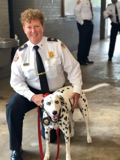 Memphis Fire Director Gina Sweat and fire dog Izzy